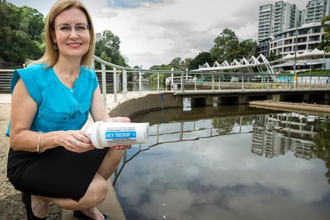 Minister for the Environment, Local Government and Heritage Gabrielle Upton tossing a GPS tracker bottle into the Parramatta River