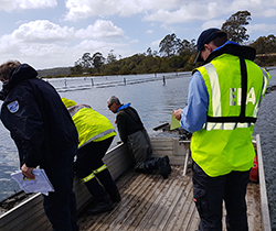 EPA staff collecting oil samples from Pambula Lake
