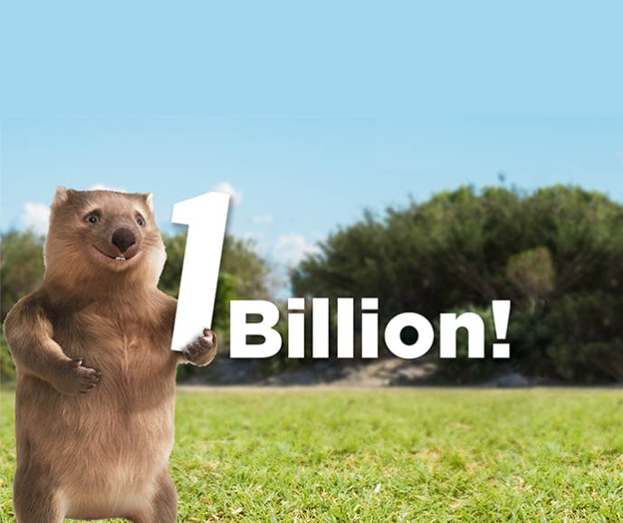 Ernie the wombat holding a 1 billion sign