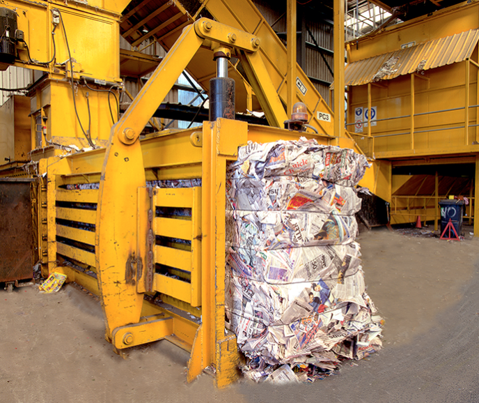 paper being compacted in a baler