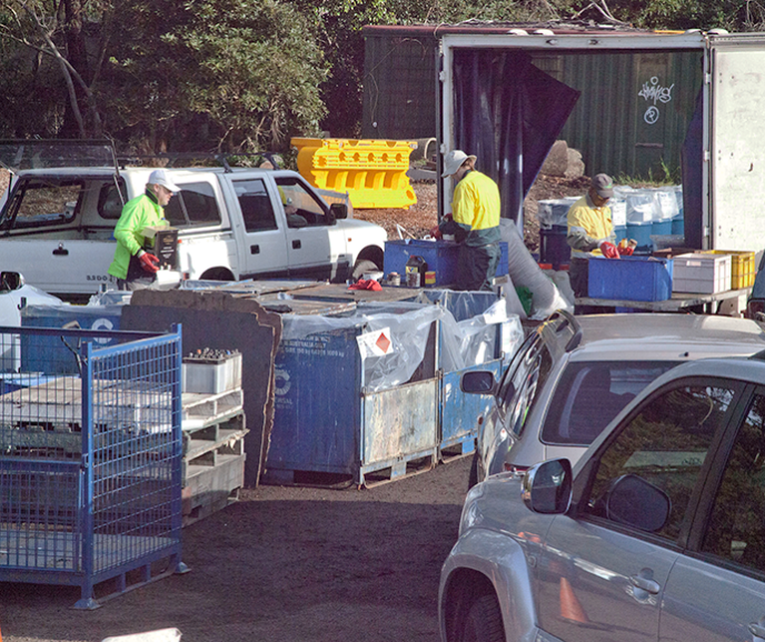 people unloading items from cars at a Chemical cleanout event