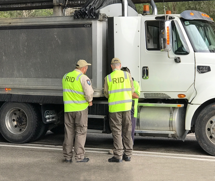 RID officers inspecting a truck