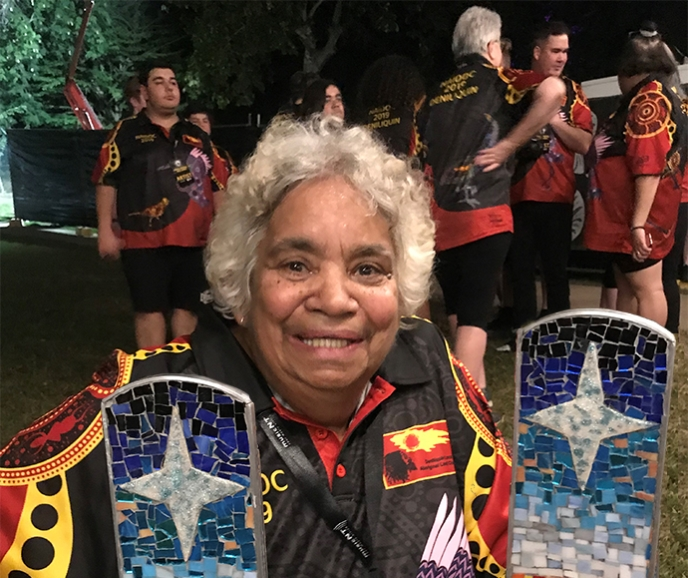 Community Elder with the Awards for the song 'State of the Heart' Credit: Desert Pea Media