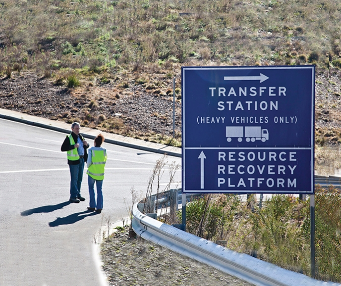 Transfer station sign beside road