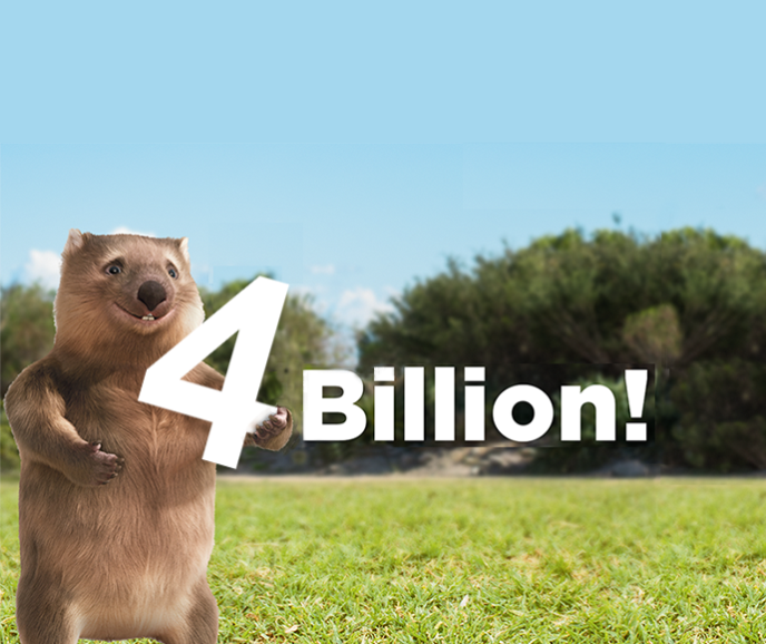 Cartoon character Ernie the wombat holding 4 billion sign