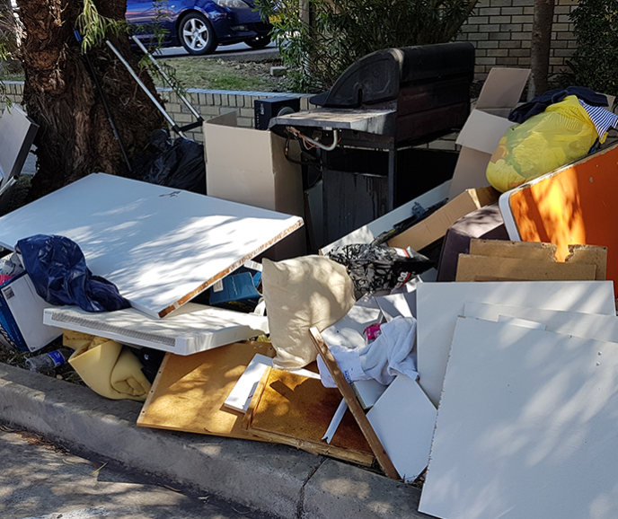 unwanted goods dumped on the footpath