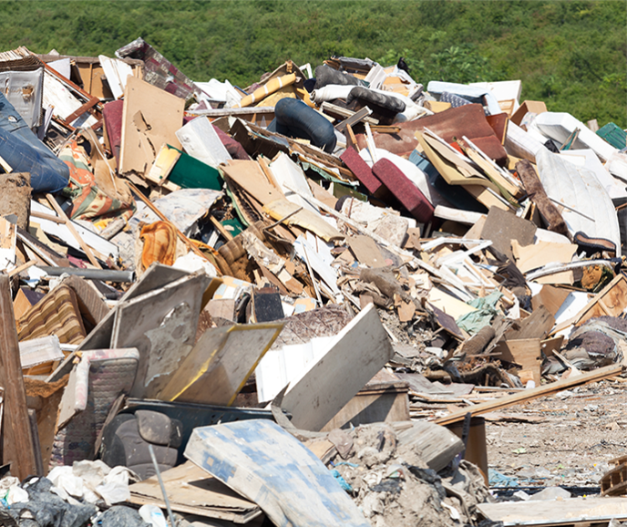 pile of flood debris - mattresses, broken furniture and other material
